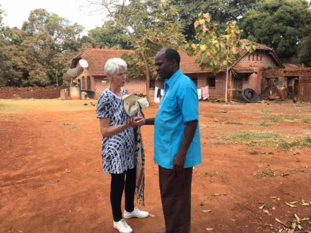 Nancy Morrison visits Father Placid at Luhombero