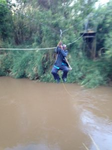 Placid on zip line over river